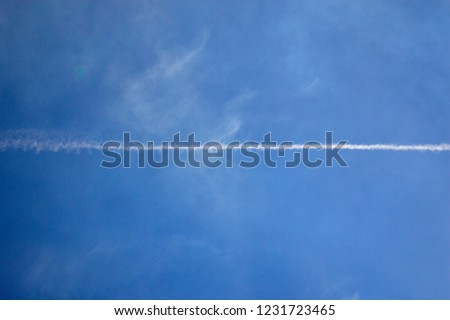Airplane Trails in the Blue Sky #1231723465