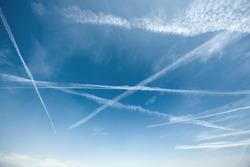 Airplane trails on blue sky