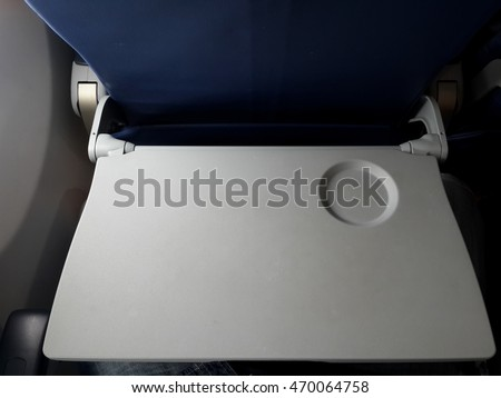 Airplane tray table on seat back ,selective focus