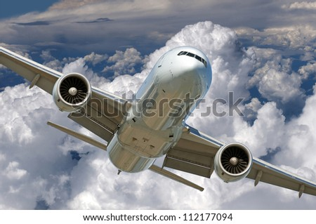 Airplane - Two jet engine aircraft in the cloudy sky