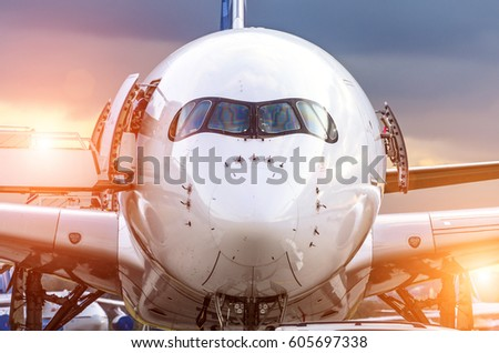 Airplane view from the front cockpit fuselage at sunset at the airport. Stock photo ©