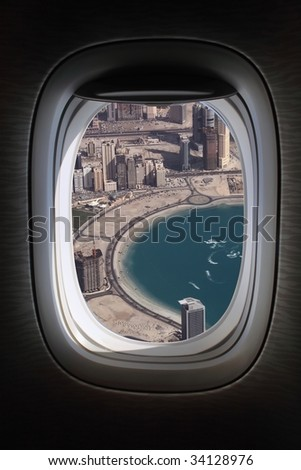 airplane window with dubai marina view