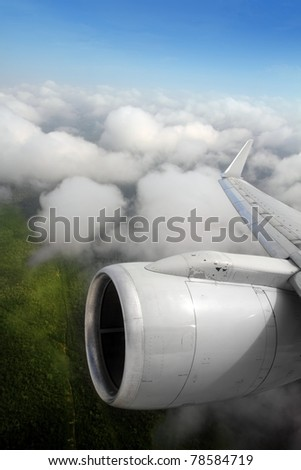 airplane wing aircraft turbine flying jungle bottom white clouds