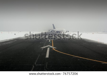 airplane wing aircraft turbine landing in snow winter runway