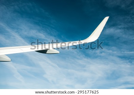 Airplane wing and clouds #295177625