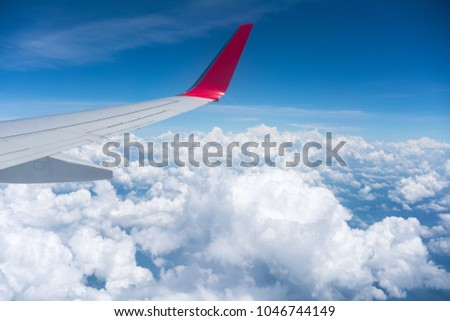airplane wing view , travel by plane #1046744149