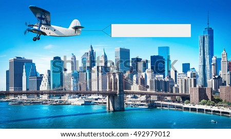 airplane with a banner over manhattan