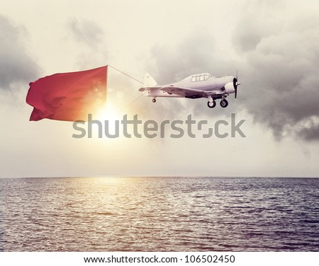 Airplane with a sign above ocean
