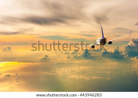 Airplane with background of cloudy sky at sunset or sunrise, exploration conceptual - Shutterstock ID 443946283