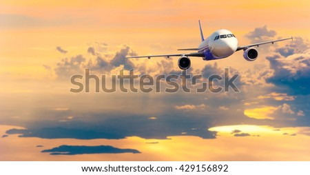 Airplane with background of cloudy sky, exploration conceptual - Shutterstock ID 429156892