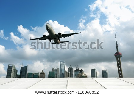 airplane with modern city in shanghai, China.