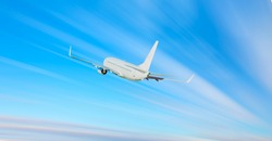 Airplane with motion blur effect at sunset. Landscape with passenger airplane is flying. Aircraft with blurred background