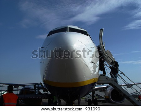 airplane with passengers entering