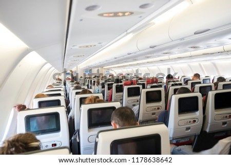 Airplane with passengers on seats waiting for take off.
