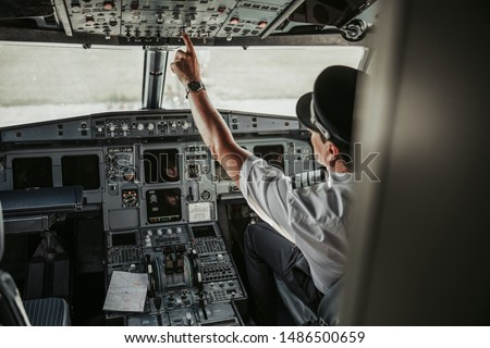 Airplane with pilot on board leaving airport stock photo. Airways concept