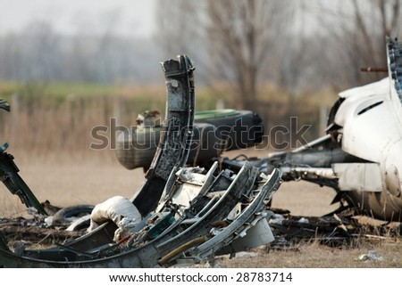 Airplane wreck on a field - stock photo