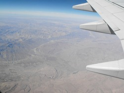 Airplanes and military aircraft, Ariel view from aircraft window of the earth and horizon