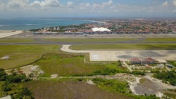 Airplanes at Balinese airport, Bali island, Indonesia. Aerial view to Ngurah Rai airport.