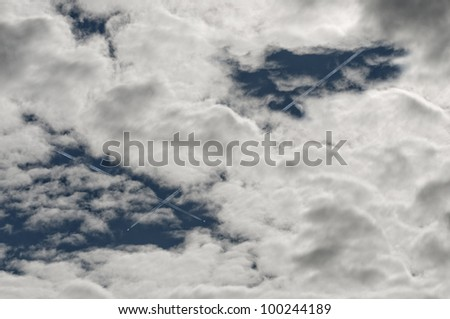 airplanes flying through the clouds