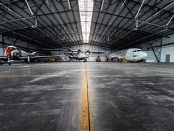Airplanes in a Hangar with yellow line