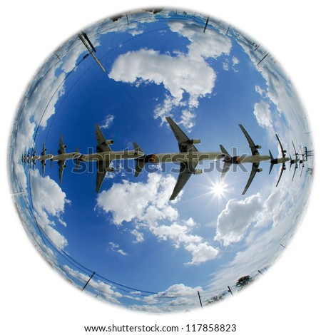 Airplanes in an earth globe with multiple airplanes and bright sunshine.