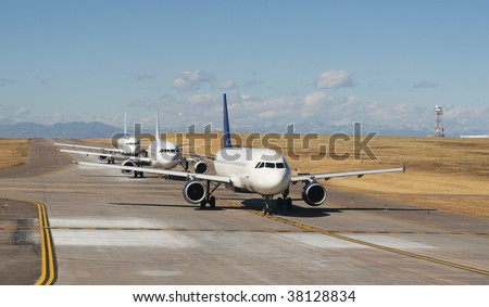 airplanes lined up for take off