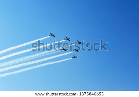 Airplanes on airshow. Aerobatics Flying Display