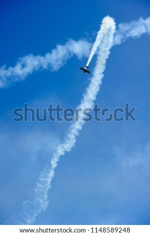 Airplanes on blue sky. Aerobatic performs flight at air show. #1148589248