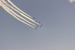 Airplanes performing an aerial acrobatics exhibition, Eagle patrol, San Javier Base, Murcia, Spain.