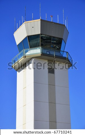 Airport: Air traffic control tower against pretty blue sky - stock photo