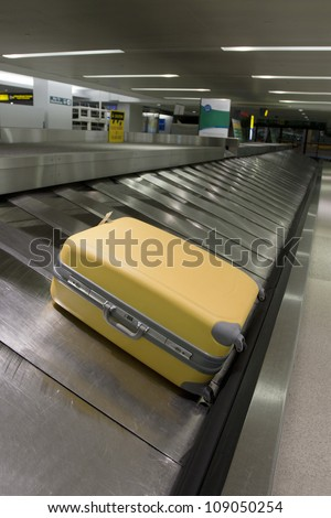 Airport carousel with a suitcase