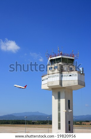 Airport control tower and airplane taking-off