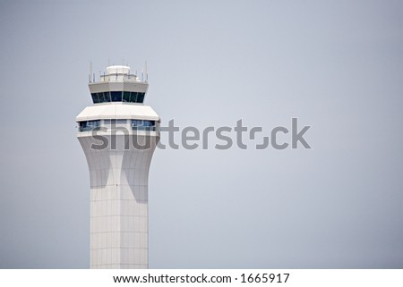 airport control tower, modern design against clear sky with copyspace