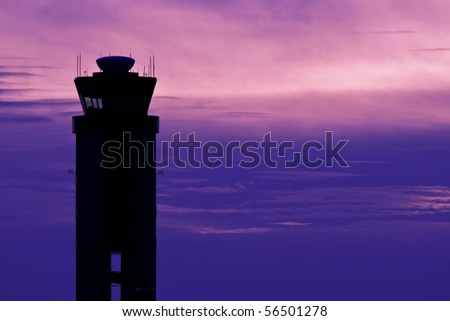 Airport Control Tower Silhouette Against Sky