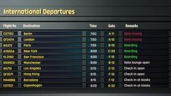Airport flight information displayed on departure board, flight status changing