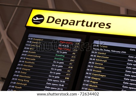 Airport flight information on a large screen international departure board