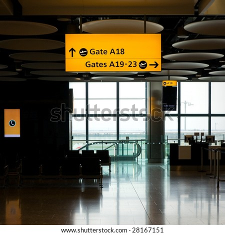Airport hall with big windows. Heathrow, Great Britain.