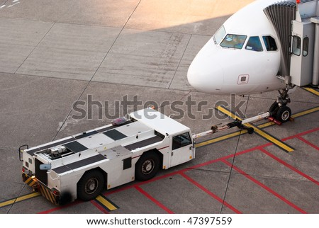 Airport. Jet and towing truck.