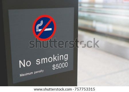 Airport no smoking area sign. Close-up of no smoking warning over airport or publick area background with copy space for text. Stop smoking concept.