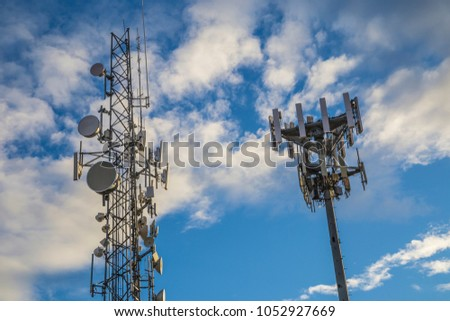 Airport radio radar tower communication technology safety blue sky clouds looking up flying waves signal