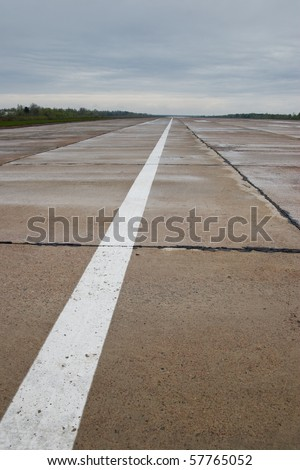 Airport runway after rainfall. White line on runway.Airport runway after rainfall. White line on runway.