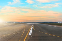 Airport runway after sunset horizon and picturesque cirrus clouds in the sky