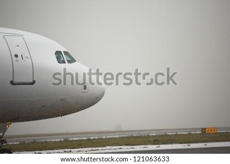Airport runway in bad weather, Prague