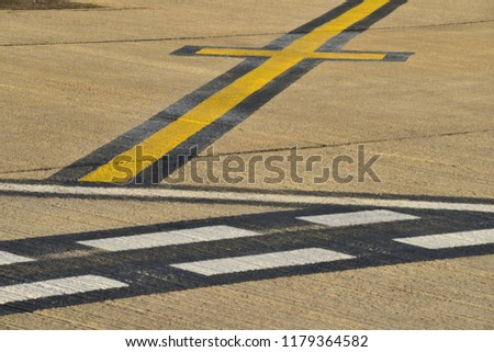 Airport runway, Jersey, U.K. Abstract image of the taxi area surface.
