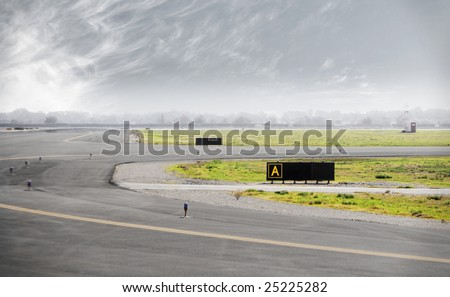 Airport Runway with storm clouds - stock photo