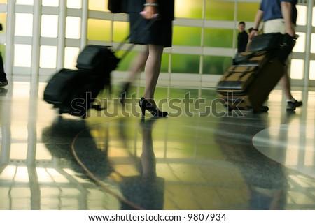 airport rush blur motion silhouette legs
