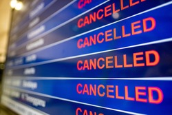 Airport screen indicating cancelled flights due to the Coronavirus pandemic
