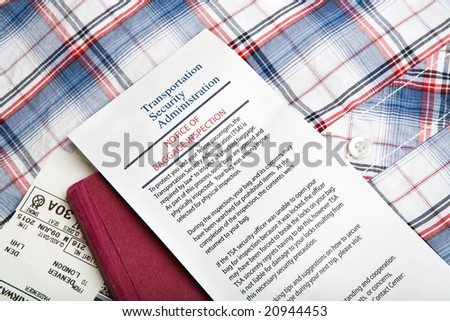 airport security - baggage inspection with notice card