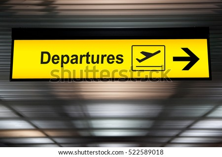 Airport sign departure and arrival board