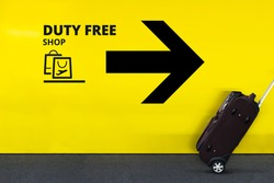 Airport Sign With Duty Free Shopping Bag Icon, Arrow and moving Luggage in Departures or Arrivals Terminal